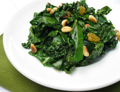 cooked Kale greens with golden raisins pine nuts Spanish Catalan